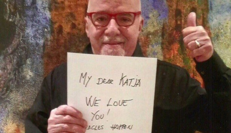 Paulo Coelho poses for a 7-year-old girl from Murmansk who has cancer